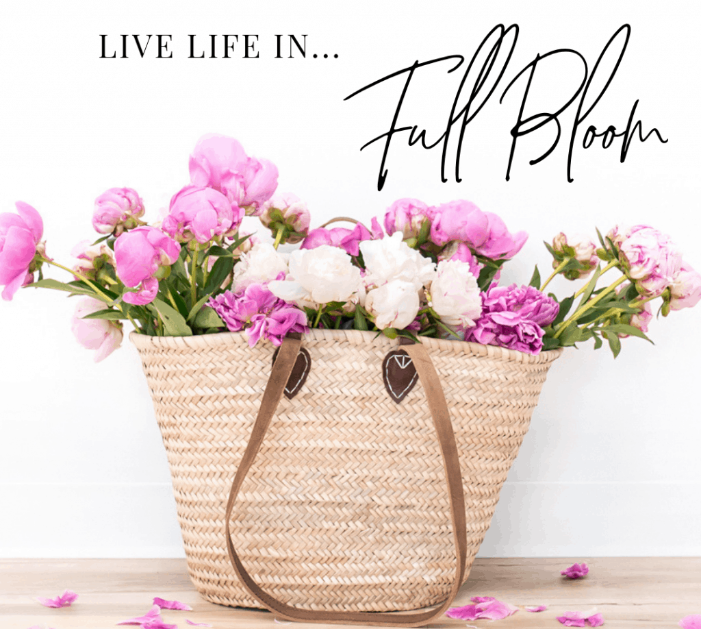 Wicker basket with pink flowers and quote is 'Live Life In Full Bloom'
