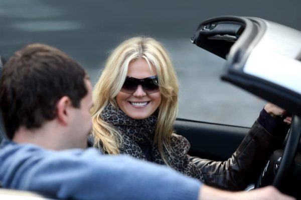 Attractive mature woman and younger man in convertible car