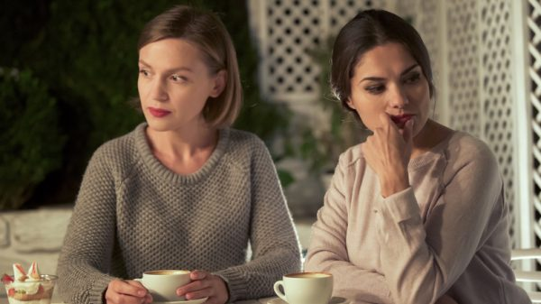 Two upset female friends in a cafe