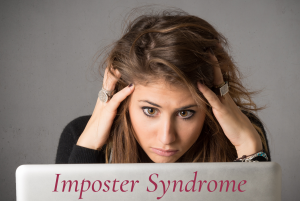 Woman looking at computer worries about imposter Syndrome