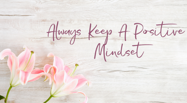 Always Keep A Positive Mindset Text on white wood background