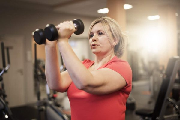 Woman using weights at the gym