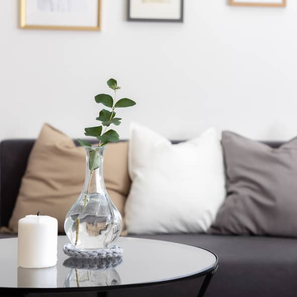 Comfy Sofa with cushions and coffee table with candle