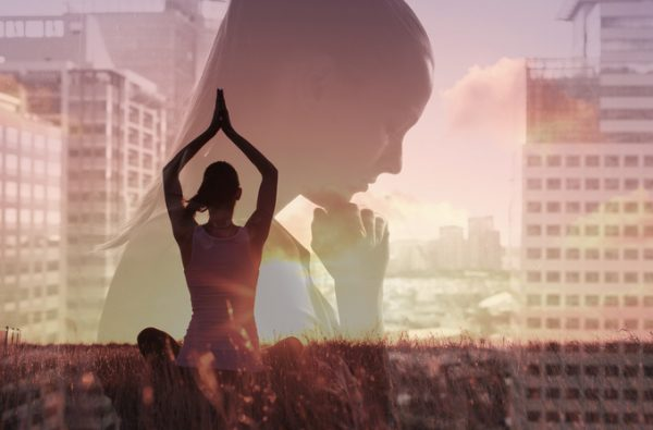 Woman practicing meditation overlaid a busy city - stress management concept