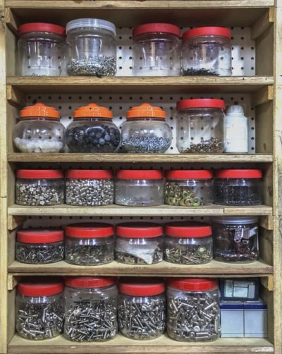 Nuts and bolts stored in old jars