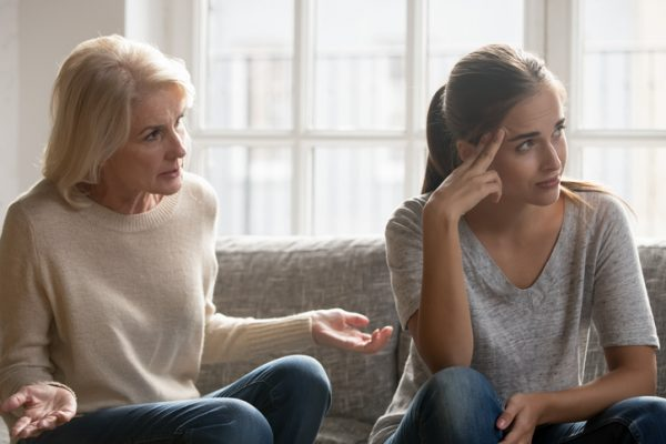 Mature mother trying to reason with annoyed daughter