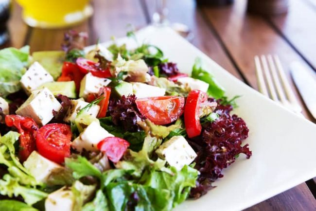 Greek Mediterranean salad with feta cheese, tomatoes, peppers, lettuce, and olives