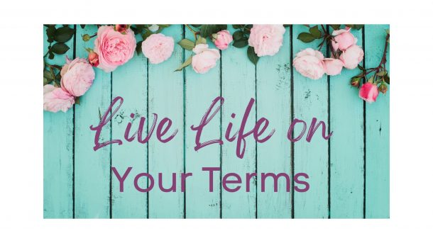 "Quote ""Live Life On Your Terms"" on Teal wooden background with flowers above"