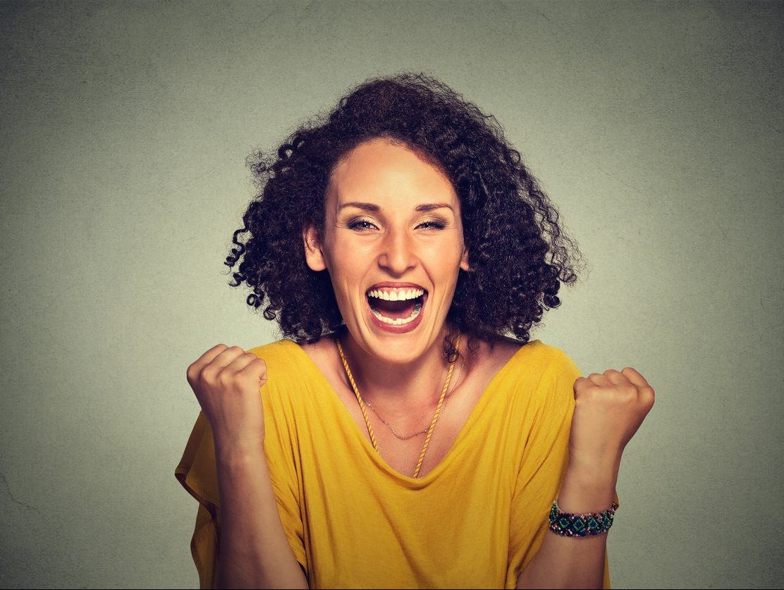 Positivity and Change concept- super positive woman exults pumping fists towards camera